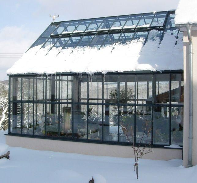 A conservatory under snowfall
